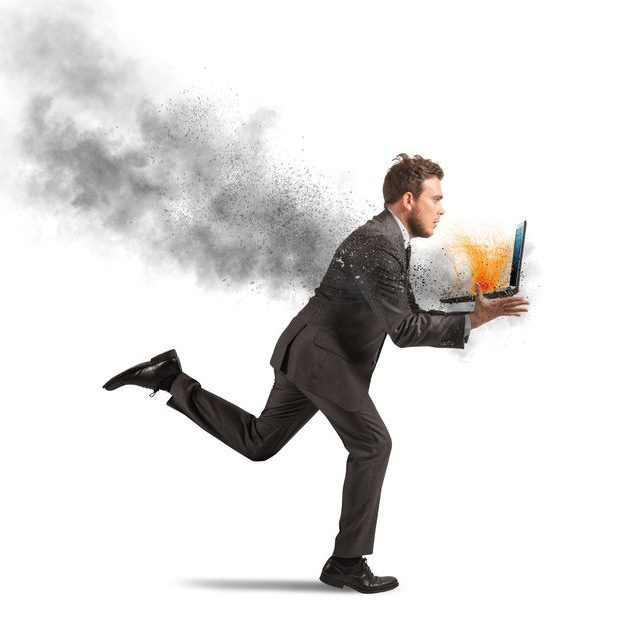 30640470 - concept of stress with running businessman with a burning laptop
